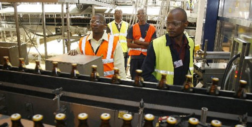 An EABL employee at one of the company's bottling plants(courtesy)