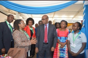 KAM Chairlady,Flora Mutahi(second left) together with Industry CS Adan Mohamed and KAM CEO,Phyllis Wakiaga(second right) during the opening of the Manufacturing expo in KICC