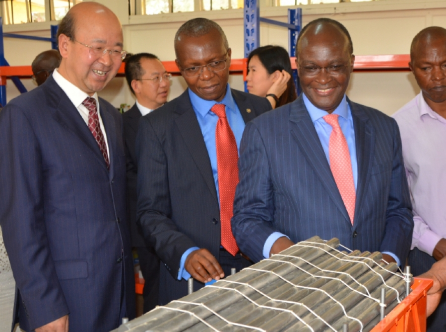 Kenya Railways MD (centre) and the CS for Infrastructure Mr. Macharia (right) look at a model of the operations of the new standard gauge railways. The MD has announced the termination of the old concession on the metre gauge railways